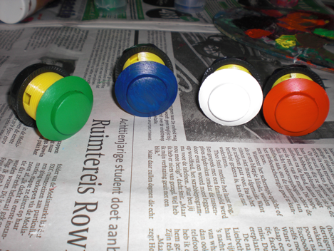 Yellow Arcade buttons painted with acryl paint